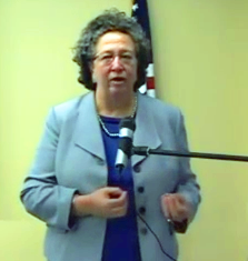 Kathy Ozer speaks at a public symposium on TAFTA on July 9th