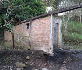 A home destroyed by landslides