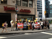 Protesters outside a Wendy's in Philadelphia show support for CIW's fair food campaign