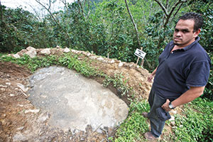 Felix Roberto Rivera, administrator at COMISAJUL, stands at an oxidation lagoon, for the environmtenally-safe processing of the acidic liquor that is generated by coffee pulp. Fairtrade rules stipulate that these waste products need to be adequately processed.