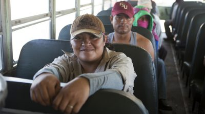 Immokalee Farm Workers waiting on bus
