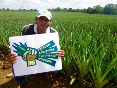 Farmer Holds Sign: Freedom and Fairness for Fyffes Workers